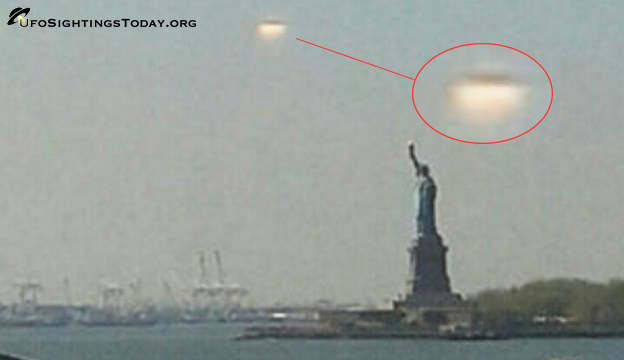 giant ufo hovers over statue of libery